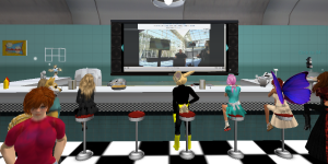 "In-world participants chat as they watch the ISTE Conference SIGVE Playground livestream at the newly installed ""SIGVE Diner on Second LIfe."